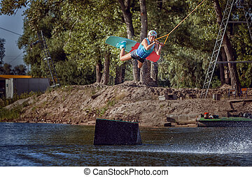 Woman extreme sports on a wakeboard. - Woman extreme sports...
