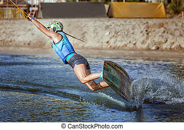 Waking on a wakeboard. - Wakeboard ride on the water at the...