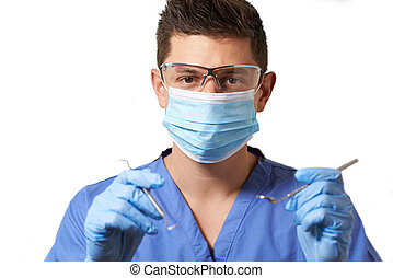 Studio Portrait Of Dentist With Mask Against White...
