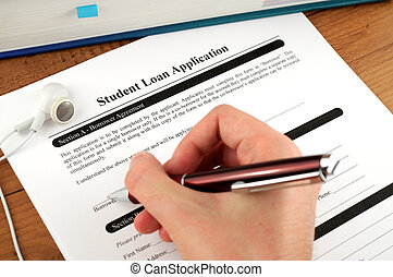 Student Loan Application Signing - Student signing a student...