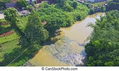 Drone Moves along River Through Rapids to Waterfall - drone...