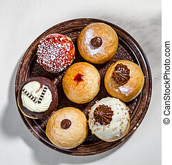The variety of sufganiyot, Jewish holiday of Hanukkah - The...