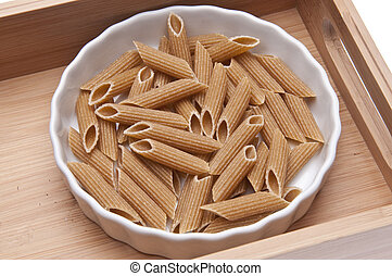 Whole Wheat Pasta in a White Dish Isolated on White with a...