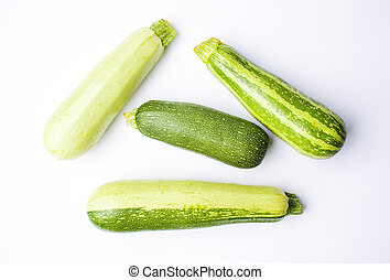 Zucchini, green summer squash on white
