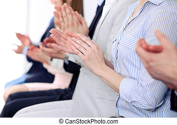 Close up of business people hands  clapping at conference