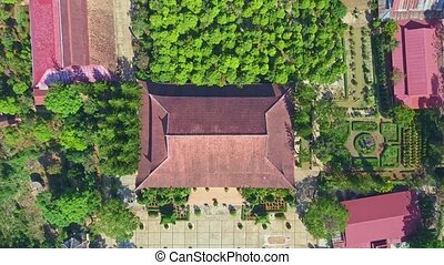 Drone Approaches Closely Pagoda Red Roof among Plants -...
