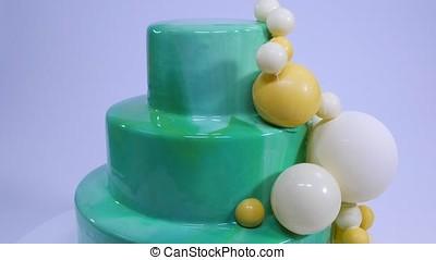 Stylish mousse cake with turquoise mirror glaze. Cake with...