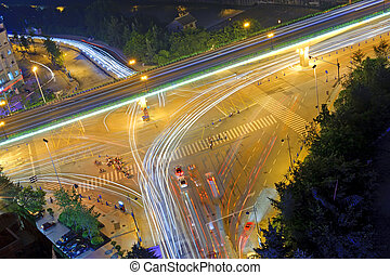 High speed traffic and blurred light trails under the...