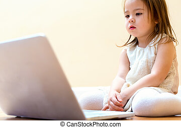 Little girl with her laptop computer