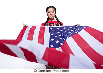 beautiful asian woman holding big american flag isolated on white, America's Independence Day concept