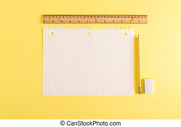 Ruler and a blank sheet of notebook paper