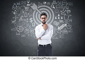 Businessman drawing icons on blackboard - Businessman with...