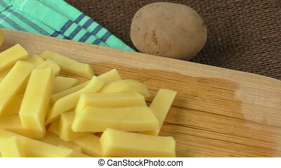 Raw potato sliced strips prepared for fries