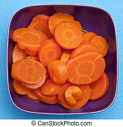 Bowl of Canned Carrots - Bowl of canned carrots on a vibrant...