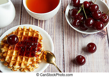 Tasty and healthy breakfast: waffles with fruit jam