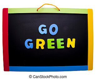 Go Green in bright letters on a school chalkboard isolated...