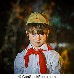 Redhead attractive boy dressed like soviet pioneer with red...
