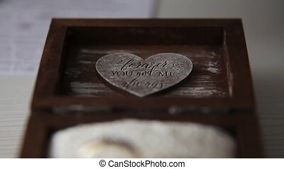Two wedding rings. - Two wedding ring in wooden box. Wedding...