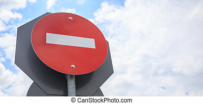 No entry traffic sign on blue sky background