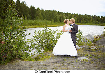 Bride and groom on nature - The bride and groom on the...