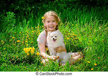 child embraces her dog