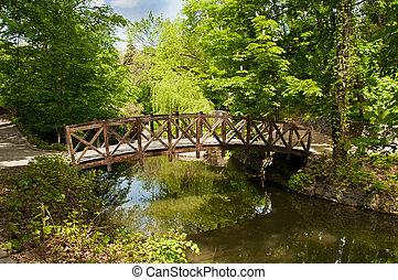 Beautiful wooden footbridge - Wooden footbridge across river...