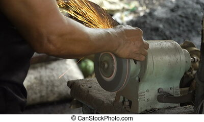 Sharpening the machete. - Sharpening the machete on...