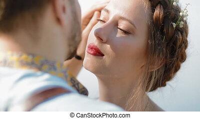 Young caucasian couple pose to photographer. Closeup...