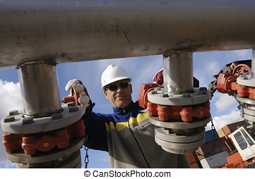 engineer turning pipeline pumps - engineer, worker turning...