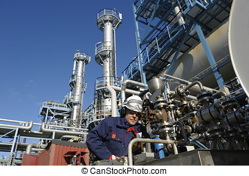 oil worker inside refinery - oil engineer working with...