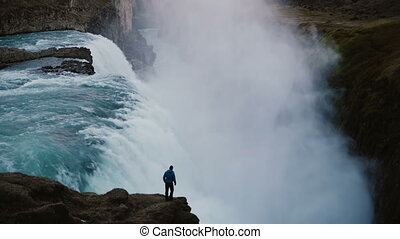 Scenic landscape of the lonely man standing on the edge of...