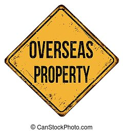 Overseas property vintage rusty metal sign on a white...