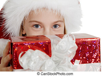Teen girl in Christmas hat with a gift