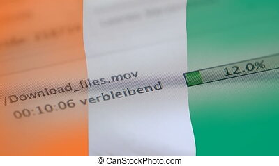 Downloading files on a computer, Ivory Coast flag -...