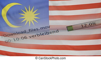 Downloading files on a computer, Malaysia flag - Downloading...