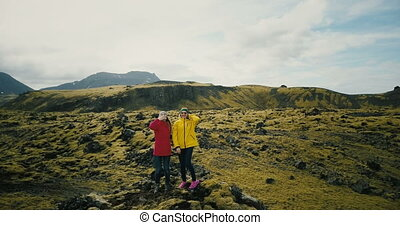 Aerial view of the two woman in the lava field in Iceland...
