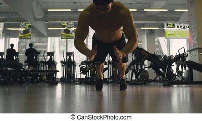 Young man doing push ups - Slow motion. Young man doing push...