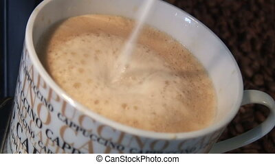 Cappuccino - Hot milk gets added into a Cappuccino