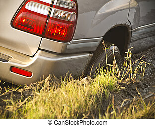 Offroad - Jammed automobile in mud, closeup