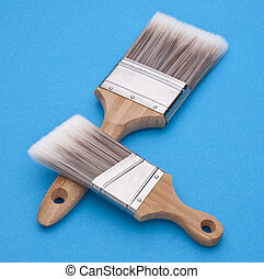 Home Improvement Scene.  Pair of Paintbrushes on Blue.