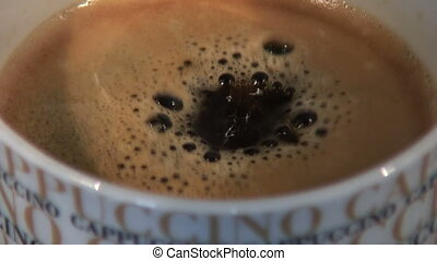 Coffee - Black coffee dripping in a cup
