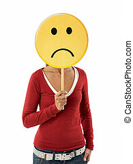 woman with emoticon - young adult woman holding sad emoticon...