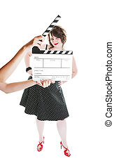 Fashion Take 2 - A clapper board being held up in front of a...