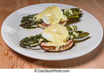 Poached egg sandwhich with asparagus on English muffin