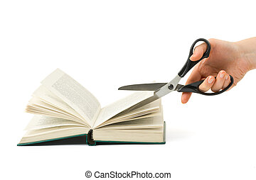 Hand with scissors cutting book