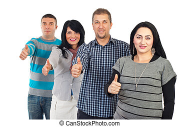 Group of people giving thumbs up and standing in a row...