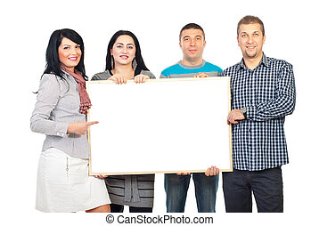 Happy group holding blank banner - Happy group of four...