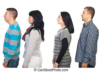 Profile of four people - Four people standing in profile and...