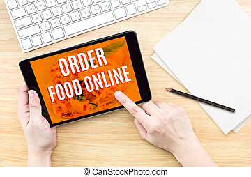 Finger click screen with Order food online word with keyboard on wooden table,Food business design concept