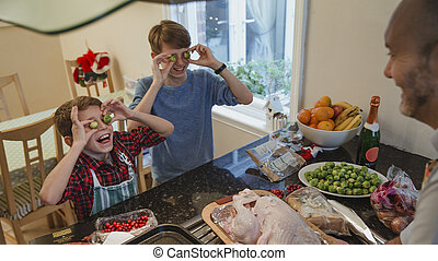 Silly Brussel Sprout Eyes - Two brothers are helping their...